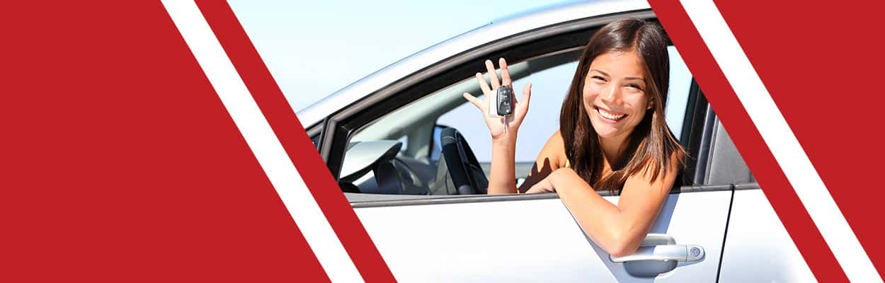 Woman sitting in car showing off car keys.